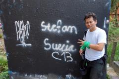 Mario framför min graffitimålning, Comuna 13, Medellín.