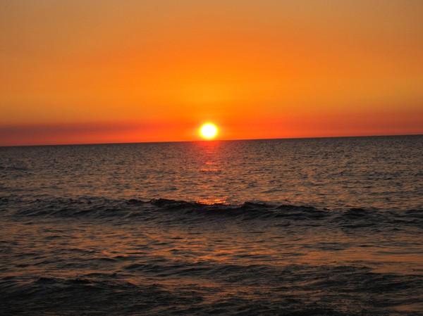Solnedgång över sydkinesiska sjön, San Juan.