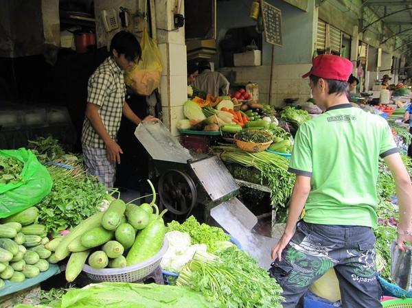 Krossning av is Ben Thanh market, Saigon.